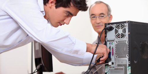 Man fixing a computer